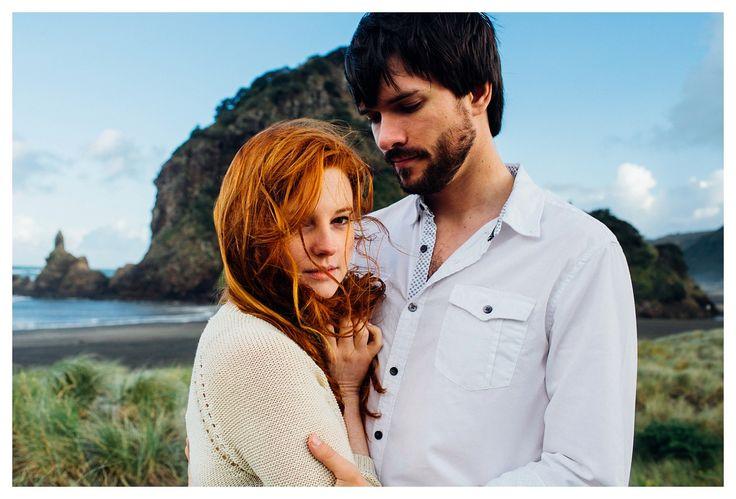 Redhead couple engagement / honeymoon at Piha beach, New Zealand