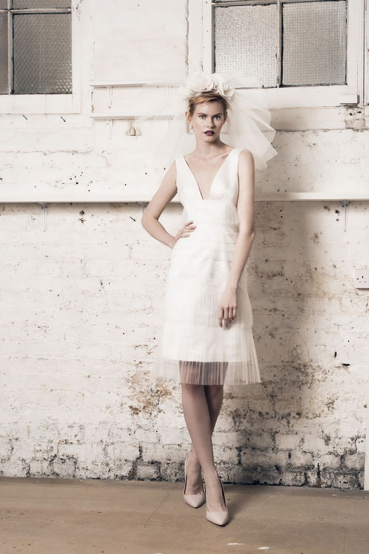 Modern wedding dress for the contemporary bride. Keira dress. Knee length dress with layers of pleated tulle and lace.
