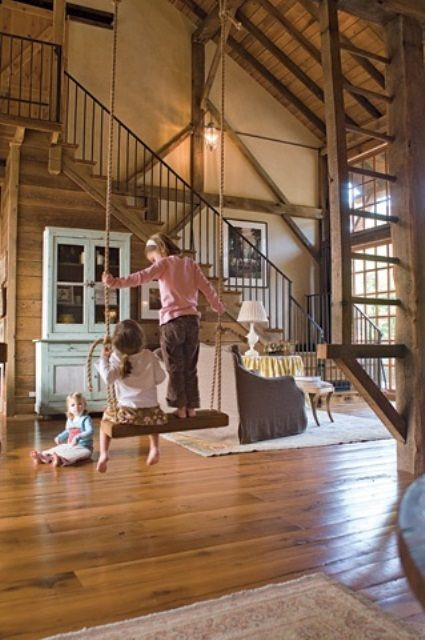 how fun to have a barn style house with a swing in the middle of the open living room