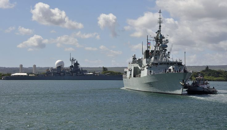 Pearl Harbor, U.S.A. 29 July 2014 - Her Majesty's Canadian Ship Calgary (FFH 335) is assisted by two harbor tugboats as the ship departs Pearl Harbor for a missile exercise during Rim of the Pacific (RIMPAC) Exercise 2014. (Photo: Sgt Matthew McGregor, Canadian Forces Combat Camera)