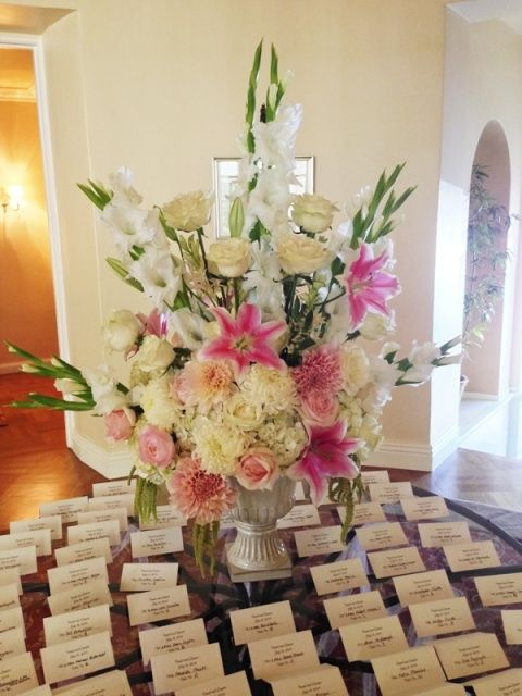 The Foyer Table Was Used As The Place Card Table With A Large Floral