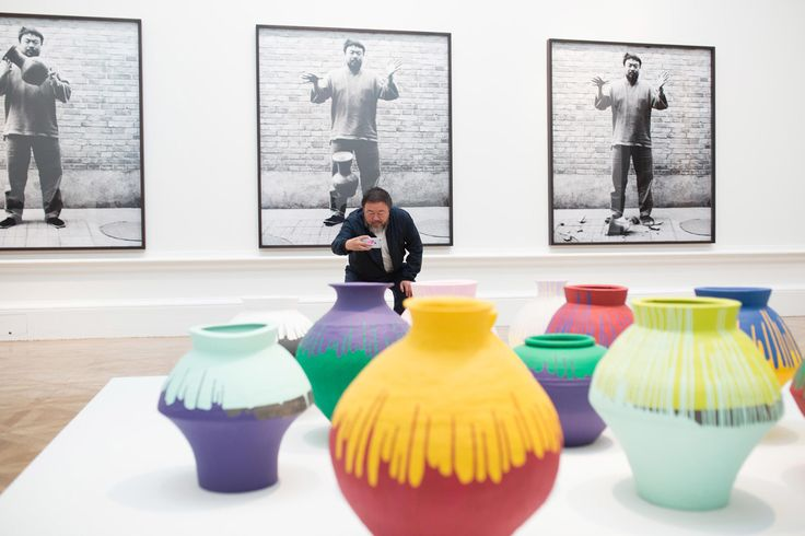 Ai Weiwei taking a photograph of his installation Coloured Vases