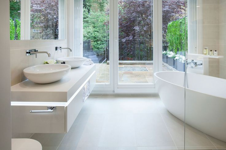 Master en-suite with freestanding V&A Bath overlooking the back garden in this property | JHR Interiors