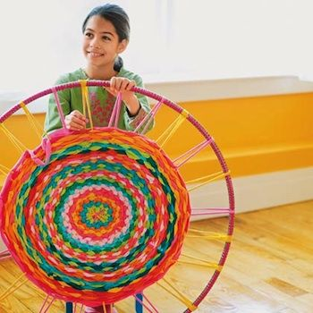 how to make a rug using a hula hoop and old t shirts - this looks really cool!! - Re-pinned by #PediaStaff. Visit http://ht.ly/63sNt for all our pediatric therapy pins