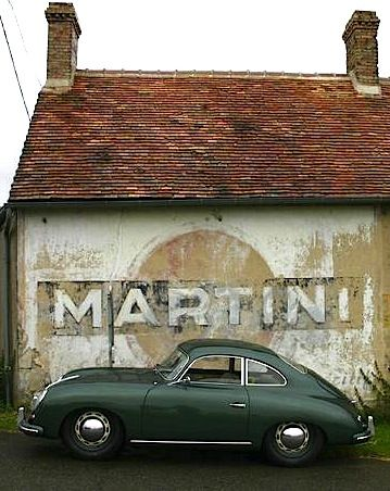 Here are two of my favorite things.  An old sign and an old car.  Perfect together.