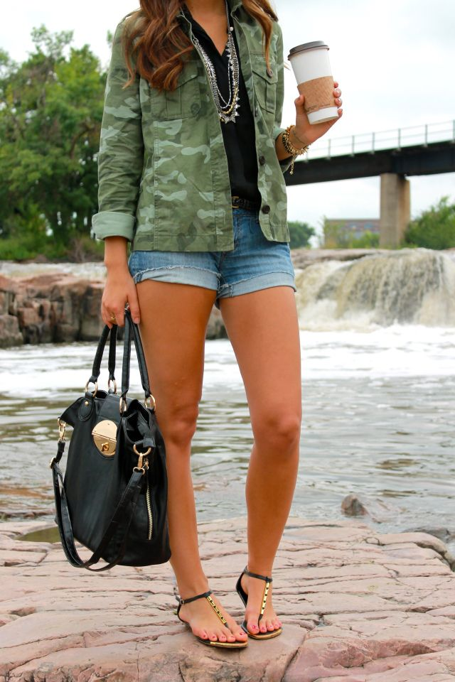 Camo jacket, black shirt, denim shorts
