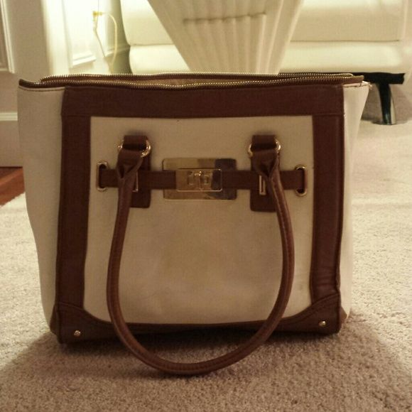 ALDO Tote Bag White and Brown With Gold Detail. You can tell I really loved this purse because it has definitely got some used to it. For the most part you can only tell it's been used a lot from the interior stains, but no wholes. : ) ALDO Bags Totes
