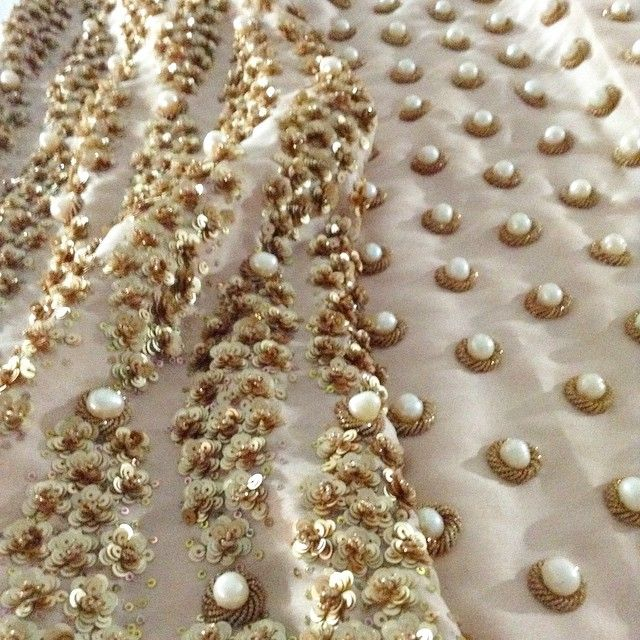 The #MuseLuxe nude dupion coat with a dense layer of gold sequins covering the back and a beautiful light grid of cream pearls decorating the front. It's beautiful. #MuseLuxeBeauty #MuseLuxeBride
