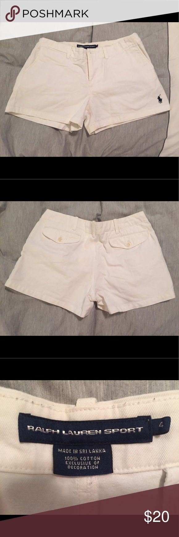 Polo Ralph Lauren white sport shorts size 4 An almost brand new pair of Polo Ralph Lauren white sport shorts. Size 4. Only worn twice and in excellent condition! Really sad I can't wear these anymore! Has the navy polo Ralph Lauren logo on bottom left shirt corner. Polo by Ralph Lauren Shorts