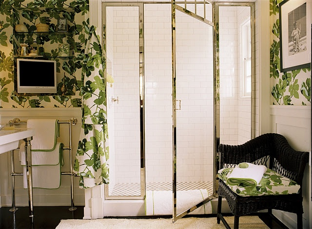 A bathroom could be a fun room to use that fab palm wallpaper with green monogrammed towels!
