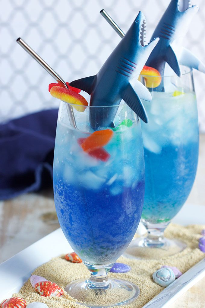 """A kid-friendly cocktail that's easy to make, this Shark Attack Cocktail recipe is as fun to make as it is to drink. The shark is filled with a """"bloody"""" surprise...just in time for shark week or any shark themed birthday party. 