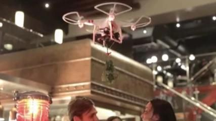 Mistletoe Drones Launching at TGI Fridays for the Holidays  TGIFridays is introducing the Mistletoe Drone to its UK locations. The drone flies over unsuspecting patrons and is fully equipped with mistletoe and a kiss-cam! Keri Lumm has the video.   http://www.histreasuresandpresence.com/2014/11/mistletoe-drones-launching-at-tgi.html
