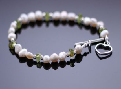 Sequana Bracelet, single strand freshwater pearl bracelet with peridot and silver.