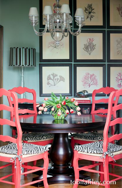 Love the coral chairs against the greed sea glass walls byTobi Fairley