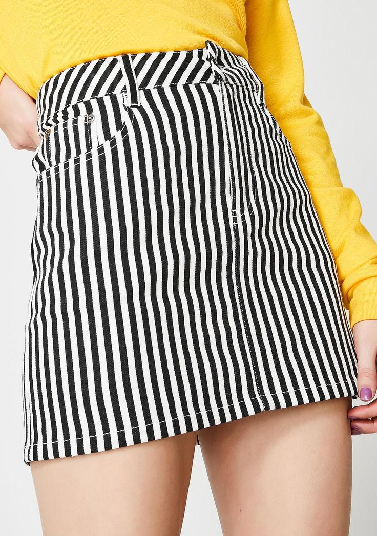 Bottom Line Mini Skirt cuz you're not gonna settle. This lil mini skirt has a black N' white striped pattern and a front button N' zipper closure.#dollskill #frontrow #newarrivals #beadoll #frontrowfridays