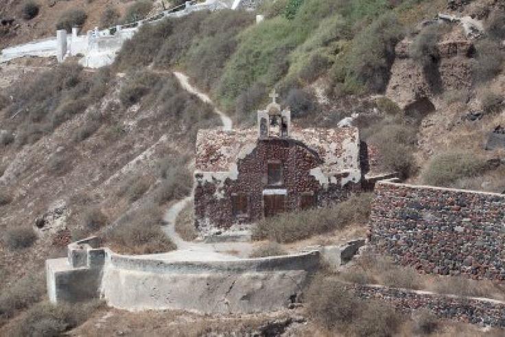 Old greek church built of rocks in Oia, Santorini, Greece