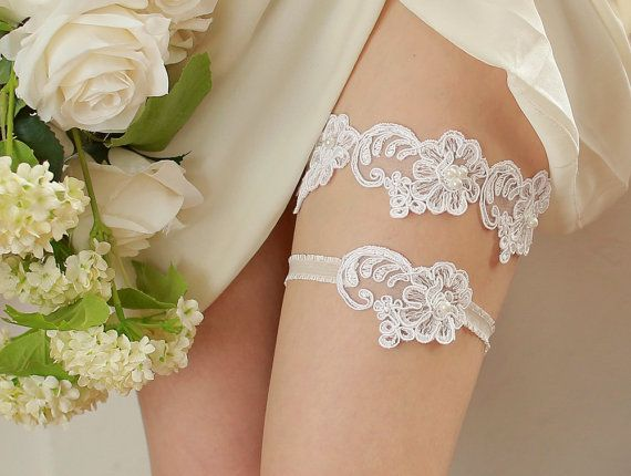 STYLE - #403 CODE:GRT030 Cloudy lace garter set. The garter set feature cotton alecone lace embellished with cream pearls.  The lace appliques are attached to stretchy organdy band for light and comfortable fit. To order yours contact us at loca@localoca.co.za www.localoca.co.za