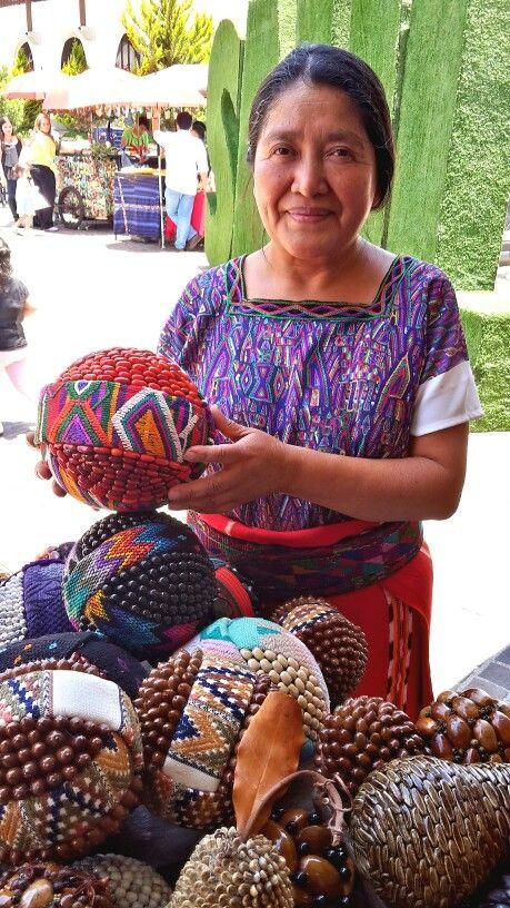 Colorful crafts Spheres made with seeds, grains and textiles from DECOESFERAS/ esferas coloridas hechas a mano con semillas, granos y textiles artesanías de Guatemala CA