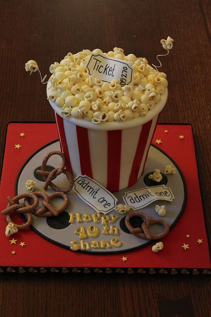 Popcorn and pretzels movie theme cake for any age. WOW!