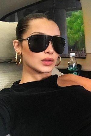 c610b3498 60+ Celebrities Wearing Hoop Earrings Ideas | Stylinnn | Versace sunglasses,  Bella hadid, Fashion