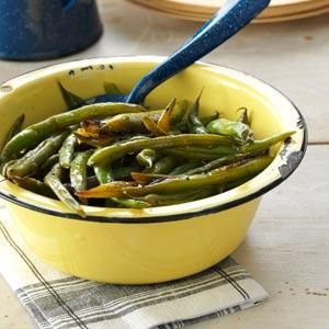 This is a perfect way to use up your garden's green beans. The Cajun flavor makes it different from your regular green bean recipe. | Grilled Cajun Green Beans Recipe from Taste of Home