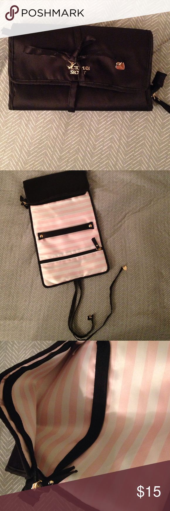 Victoria's Secret Jewelry Bag Great condition. Satin material. Two zipper compartments. Rolls up and ties for on the go jewelry storage. Victoria's Secret Jewelry