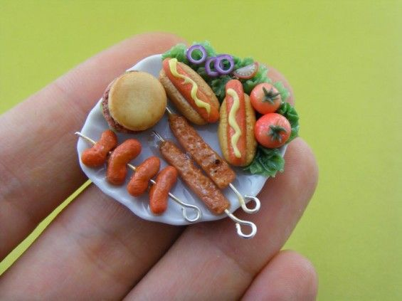 Shay Aaron creates delicious looking, incredibly small,  and extremely photo realistic sculptures of all your favorite food items from a delicious stack of cupcakes to the most tasty BBQ favorites. The only shortcoming of the work is that I'd have to eat at least 100,000 pieces by her