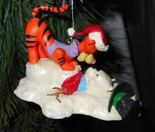Hallmark-Keepsake-Ornament-Pooh-Tigger-Bounce-Practice-2005-QXD4092 Tigger head is on a spring and wiggles. Measures 3 x4 inches.