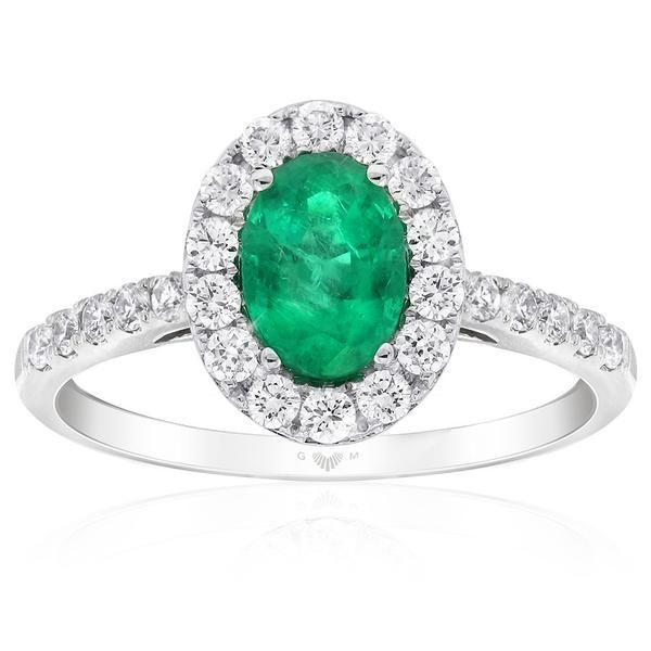 The luminescent Aura ring design by Gerard McCabe. Featuring a bright green, natural emerald surrounded by brilliant white diamonds. Crafted in 18ct white gold. Allow 6 weeks to custom make this ring for your finger size. The Aura ring is specially design