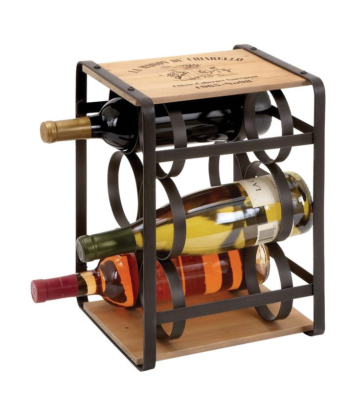 Harvey & Haley  Wine Holder in Brown Colored Metal Frame. Features: Brown colored metal frame Holds six bottles of wine Evenly placed circular rings of metal Fusion of metal and wood  Description: The metal wood wine holder is an apt gift to be given to an avid drinker. It is designed with brown colored metal frame and two wooden planks at the top and bottom. Ideal to hold six bottles of wine, this wine holder comes with evenly placed circular rings of metal for convenient storage. The wine…