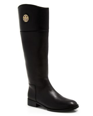 Signature logo detailing lends a polished accent to these wear-forever riding boots from Tory Burch. | Upper: leather; lining: leather/textile; leather manmade sole | Made in Brazil | Available in ful