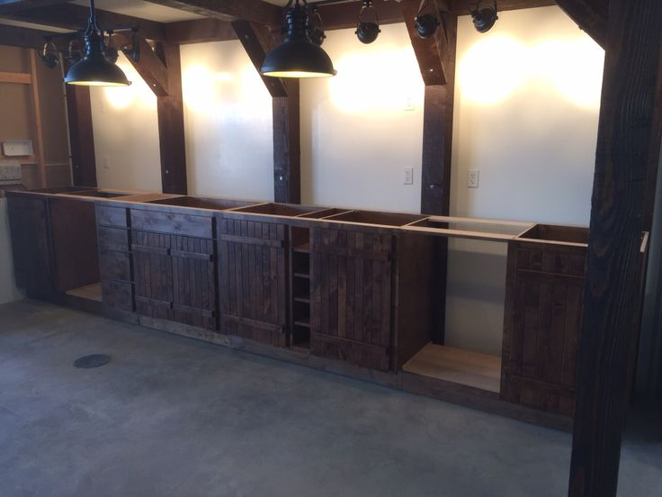 Knotty alder lower cabinets ready for tops in party barn!
