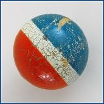 My toy of choice doing tricks against a wall. The red, white and blue rubber ball.