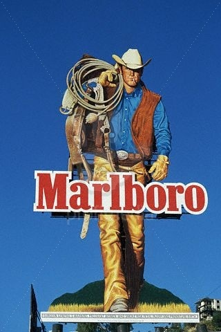 """The original advertising involving the Marlboro Man featured paid models pretending to carry out cowboy tasks. However, Leo Burnett felt that the commercials lacked authenticity. In 1968, he hired Wyoming rancher Darrell Winfield of Riverton, Wyoming who became known as the original """"Marlboro Man."""" Winfield, born in 1929, died at 85 years old in Wyoming in 2015."""