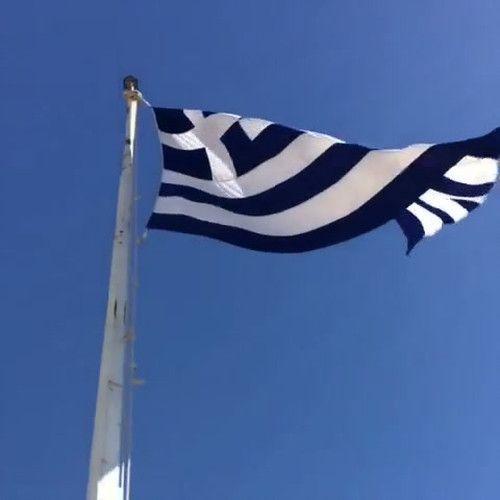 Waving Greek flag near the Parthenon.
