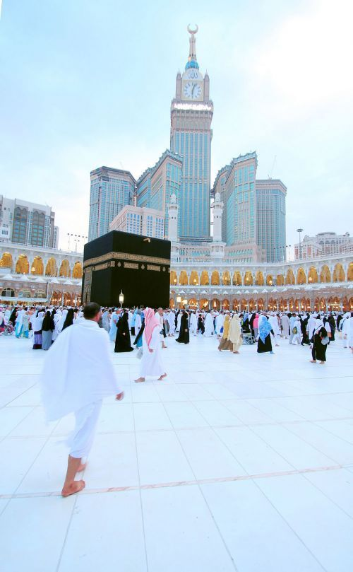 View of the Ka`ba with Abraj al-Bait Behind. It looks so pure and amazing x