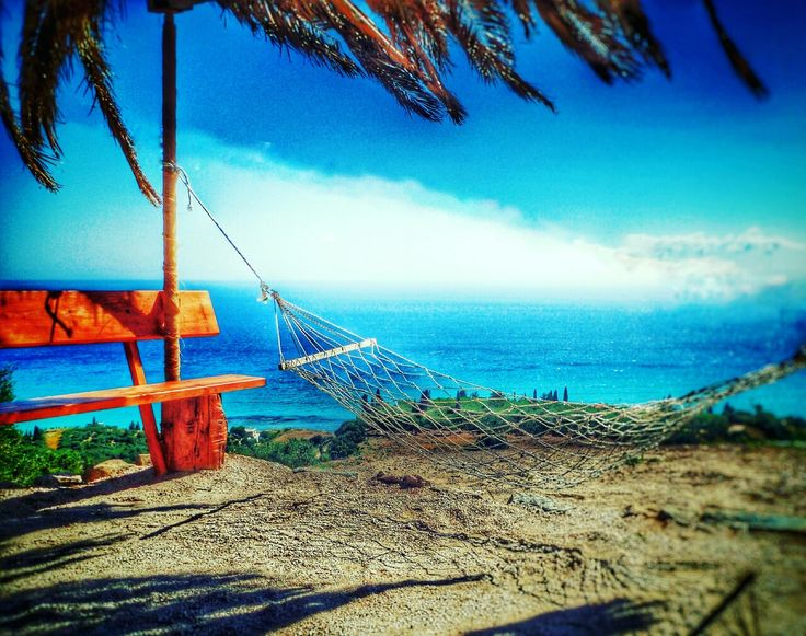 Seat and Hammock at the side of the coast road north of Alykes on Zakynthos island Greece Photography by Alistair Ford