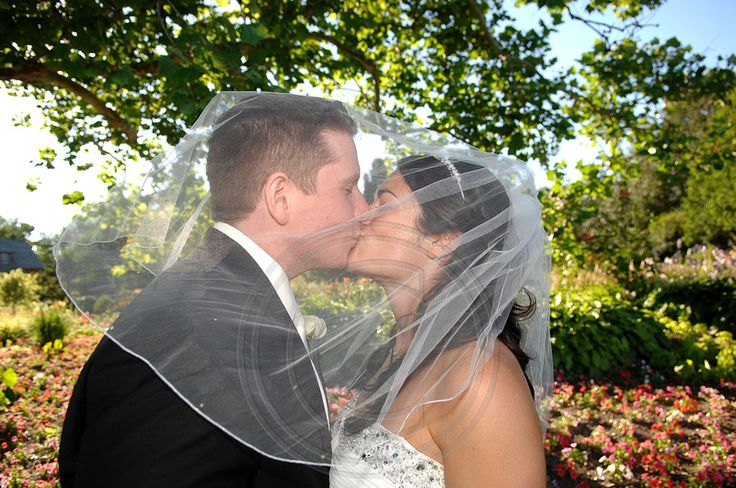 The Bride and Groom steal a moment under the Bride's Veil at Experimental Farm in Ottawa