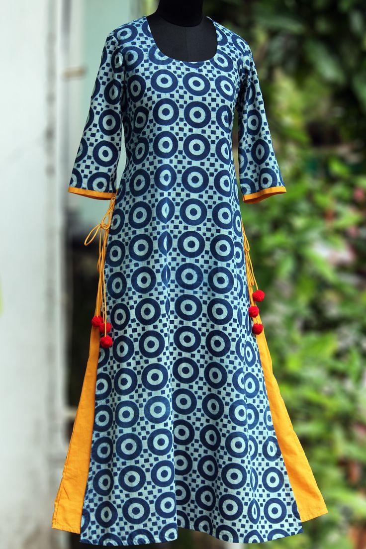 a long kurta in layers with handblock printed indigo fabric & pop coloured inner layer. the layered kurta has tie-ups and woolen fumdas to add to the pop!
