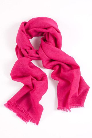 Irresistible Fuschia 100% Cashmere Shawl:   Crafted from the finest quality cashmere, this stunning fuschia shawl makes a chic statement of radiance, beauty and warmth. A perfect gift for cosmopolitan women.  Features include:      100% Cashmere      Handwoven with French cut ends;      Size - 75 x 195 cm;      Weight - 175g;  Karma Cashmere shawls are authenticated with a Chyangra Pashmina logo. This hallmark guarantees that the highest quality and most genuine cashmere is used in our…