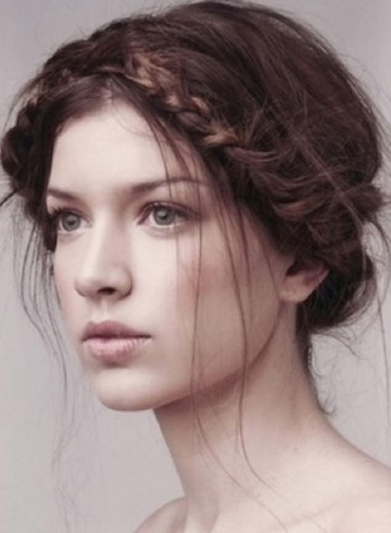 Messy sexy prom hairstyle with braid wrapped around the head looking so romatic
