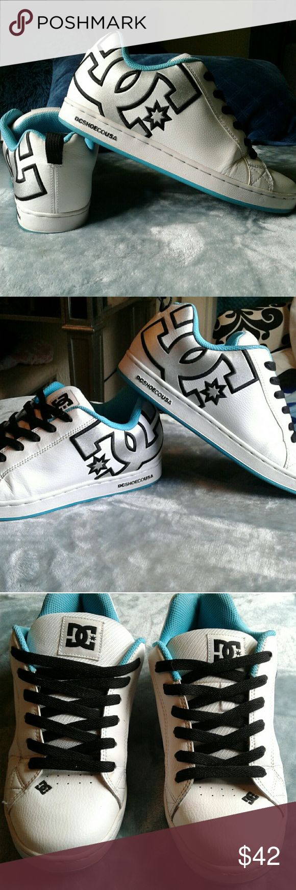 DC Shoes women's white shoe side logo 7.5 Women's pre loved great condition DC SHOES 7.5. White shoe, black laces, teal accent color, silver metallic DC logo on sides of shoes. DC logo on tounges. These shoes NICE!!! Thanks for looking!! DC Shoes Shoes Sneakers