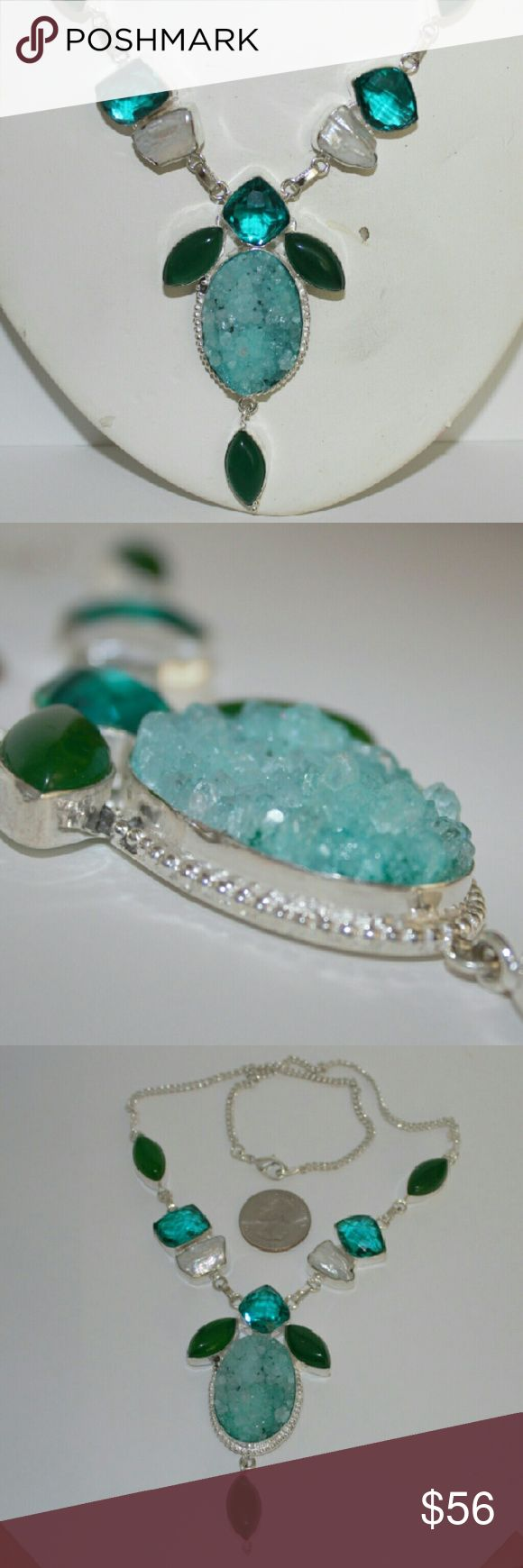 """Amazing blue Druzy statement necklace NWOT Incredible turquoise blue druzy pendant flanked by aquamarine and emerald stones. Biwa pearls ascend on the stunning mix of stones accenting the pendant. Nickel-free silver chain with lobster clasp. Necklace is 19"""" and pendant hangs an additional 3"""" at base. Turn heads where ever you go with this statement necklace. Imported from India. Bundle pricing available. Jewelry Necklaces"""