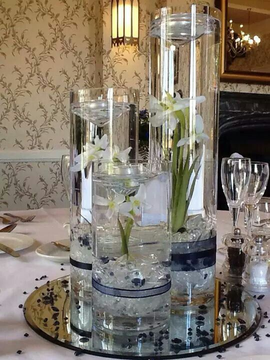 Centre Pieces Tiered Cylinder Vases With Floating Candles Wedding Pinterest Cylinder Vase