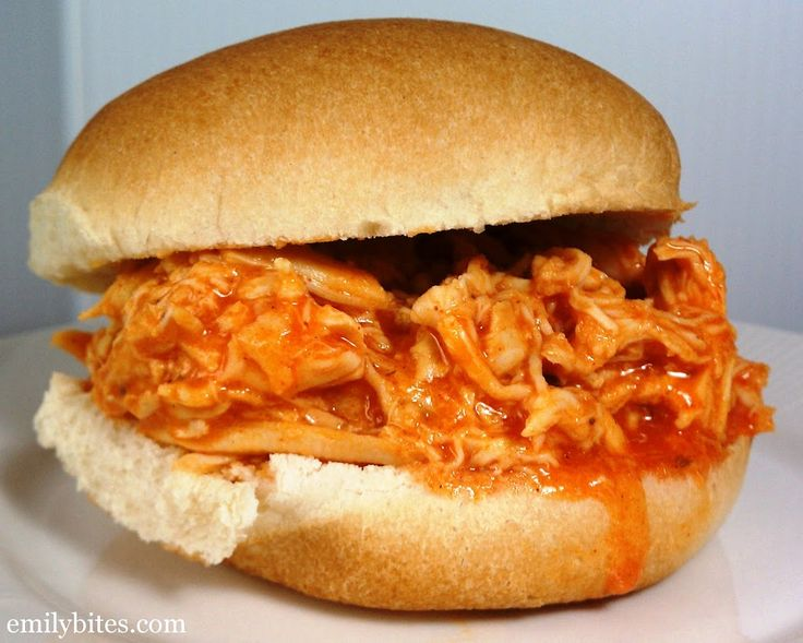 Slow Cooker Buffalo Chicken - just four ingredients and no prep! Easy and delicious for just 175 calories or 3 Weight Watchers points per serving. www.emilybites.com #healthy