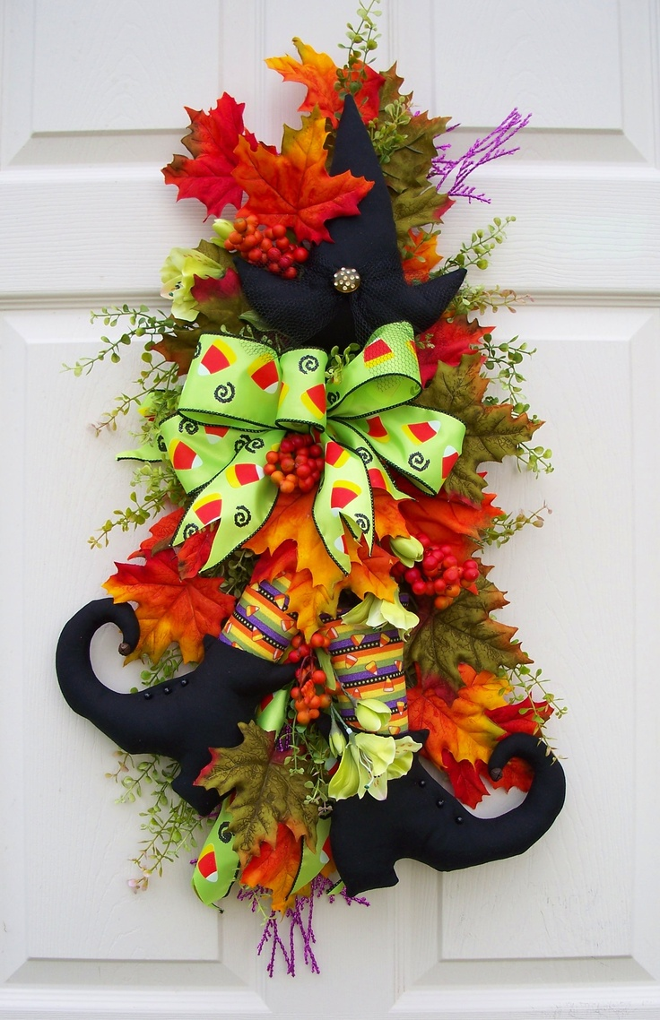 Fall/Halloween swag for the front door. It will fit between the storm door and the front door. Truly one of a kind.  http://www.timelessfloralcreations.com/