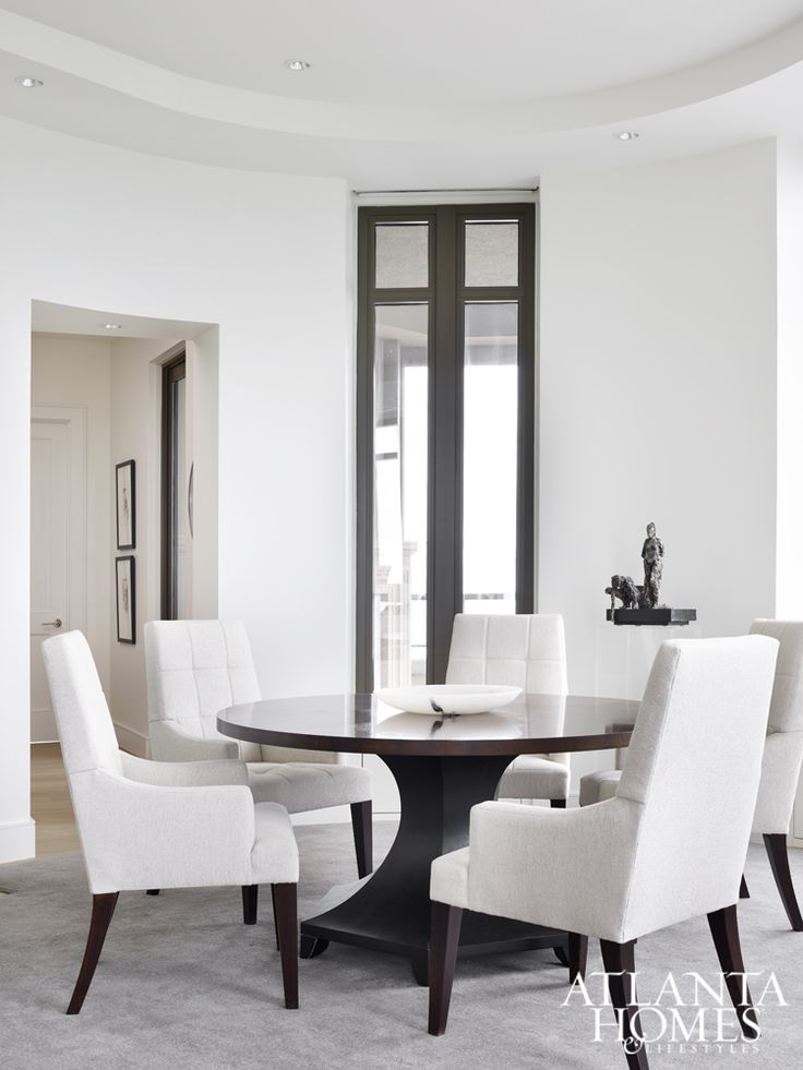 Brown divided the shapely living room into three distinct areas, including  two for seating and  White InteriorsDesign ...