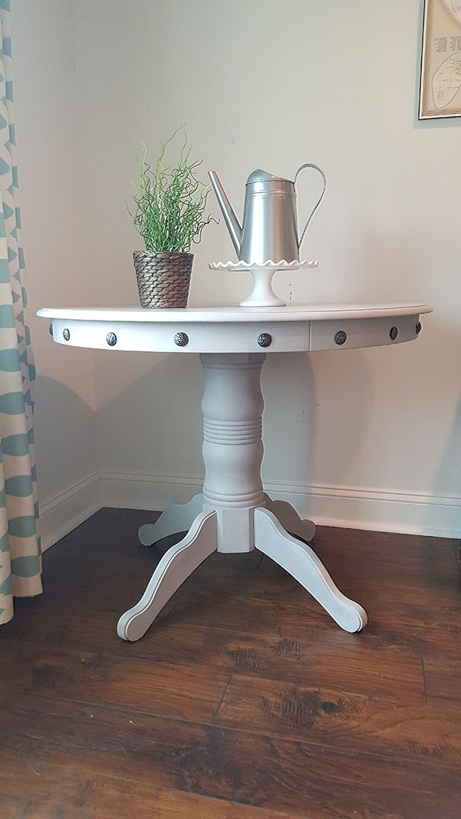 Pedestal table makeover - a fresh coat of paint and nailhead trim detail give this old pedestal table a whole new look.