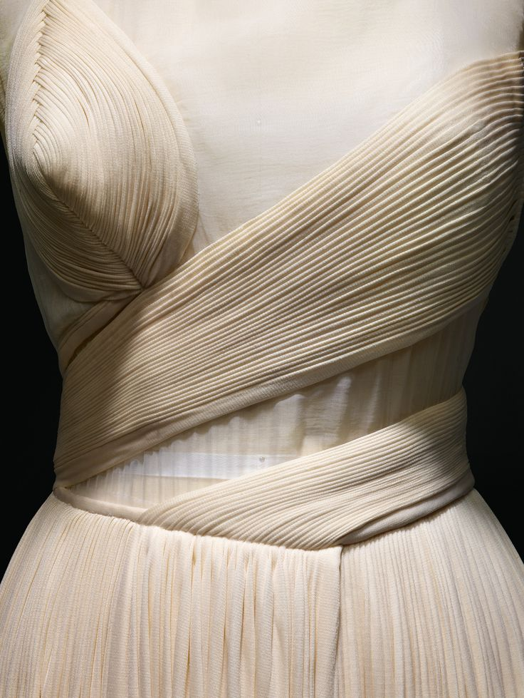 Madame Grès (Alix Barton) (French, 1903–1993). Evening Dress(detail), 1987, Haute Couture. Machine–sewn white silk organza, hand–stitched and –applied pleats of white silk jersey, hand–stitched bindings at neck and arms. Photo © Nicholas Alan Cope. #ManusxMachina #CostumeInstitute