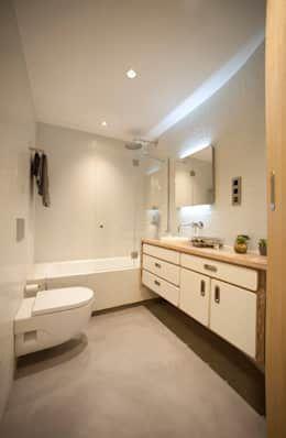 Piso de concreto pulido para un baño moderno https://www.homify.com.mx/libros_de_ideas/3984190/pisos-de-concreto-pulido-18-ideas-que-te-van-a-encantar